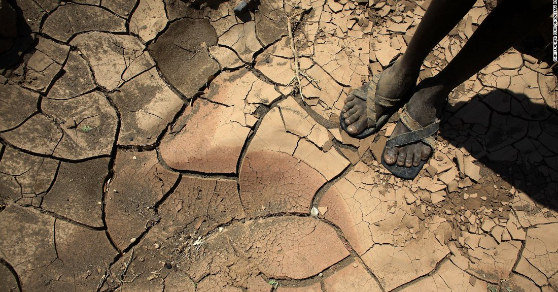 Image of boy standing in dry land. Extreme heat is one the result of Global Warming. Help us in our fight against Climate Change